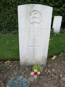 The grave of Roger Schunck in Ypres Town Cemetery.  Photgraphed for 'Marching in Memory' for Combat Stress, July 2015
